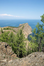 View of the rocky shore near Cape Khoboy, Olkhon Island, Lake Baikal, Siberia, Russia.