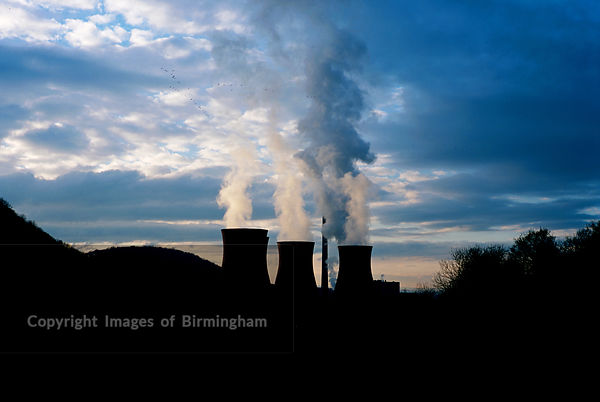 Coal burning Ironbridge Power Station, Buildwas, Telford, Shropshire. Smoke, pollution, sunset, birds, sky, electricity.