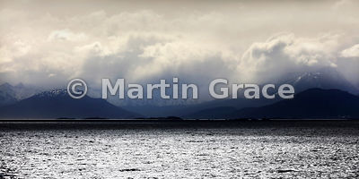 2:1 format spectacular landscape of Tierra del Fuego and sunlight coruscating on the Beagle Channel, Argentina