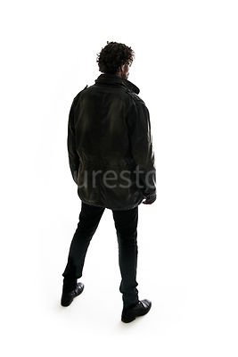 A mystery man, from behind, in silhouette, looking away – shot from eye level.