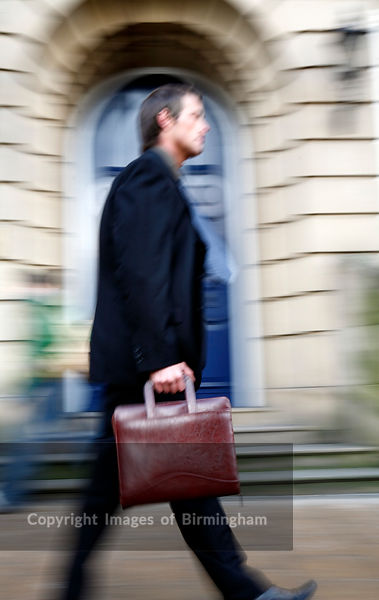 Businessman carrying a briefcase in financial district of Birmingham, on Colmore Row.