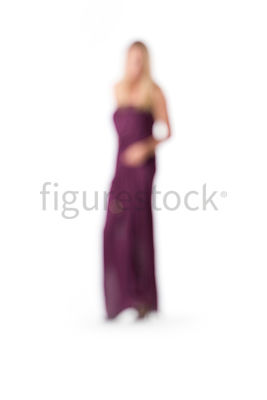 An abstract image of a blonde woman in a purple evening dress – shot from mid level.