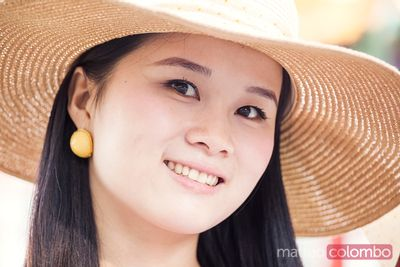 Portrait of young chinese woman outdoors