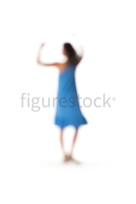A blurred dancing woman in a blue dress – shot from mid level.