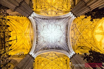 Ornate ceiling inside the Cathedral of Seville, Spain