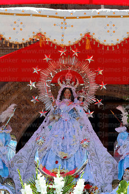Figure of Virgen de la Candelaria during central mass, Puno, Peru