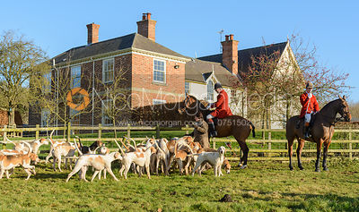 The Cottesmore hounds in front of the house.