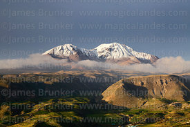 View of Nevados de Putre / Taapaca volcano and hillsides above Putre, Region XV, Chile