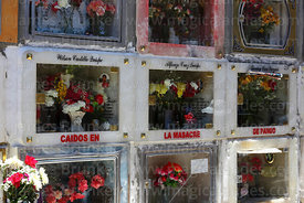 Decorated tombs in cemetery in memory of victims of the Pando massacre, Todos Santos festival, La Paz, Bolivia