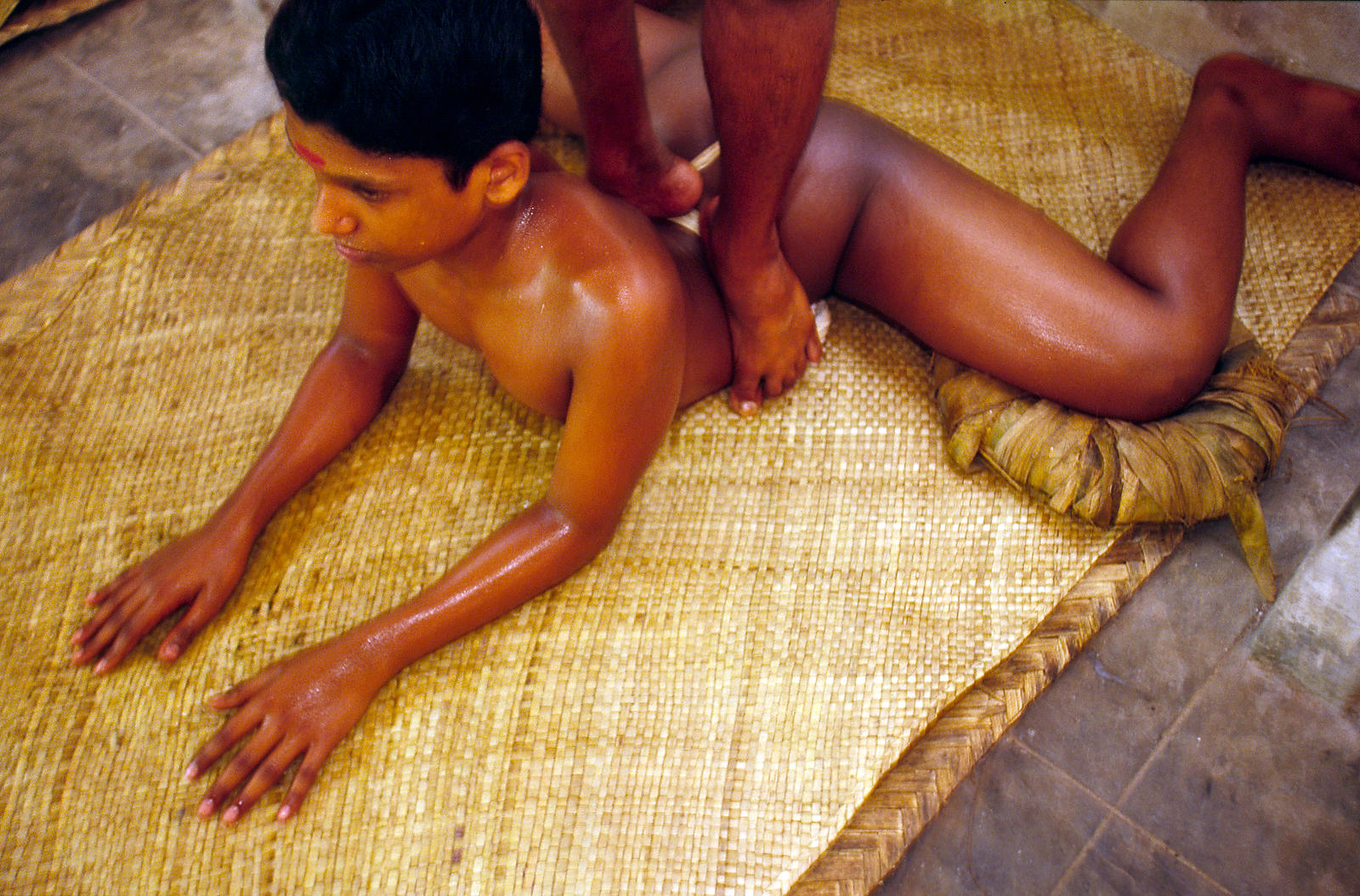 A boy is massaged by his teacher