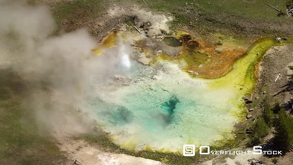 A striking turquoise and yellow pool in the Midway Geyser Basin, Yellowstone National Park