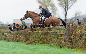 Timmy Edwards jumping a hedge near East End
