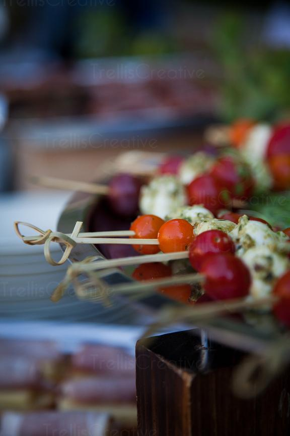 Fresh mozzarella and tomatoes on bamboo skewers