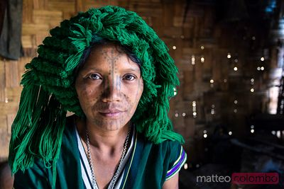 Portrait of woman of chin tribe with facial tattoo, Myanmar