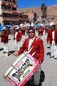 Man playing bass drum in brass band, Chutillos festival, Potosí, Bolivia