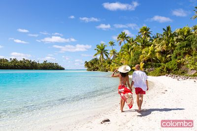 Tourist couple walking on the beach, One Foot Island, Aitutaki, Cook Islands
