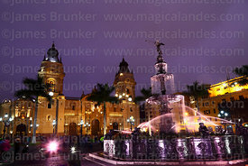 Fountain and cathedral at sunset, Plaza de Armas, Lima, Peru