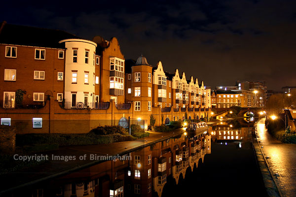 Canals in Birmingham at night, showing apartments