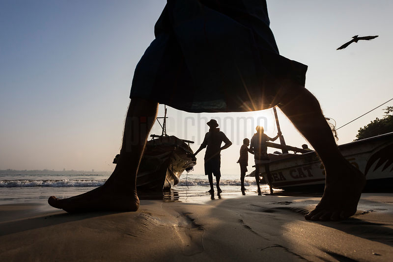 Fishermen Preparing to Bring their Boats up onto the Beach at Sunrise