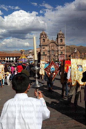 Choirboy holding candle during parades for Corpus Christi festival , Plaza de Armas , Cusco , Peru