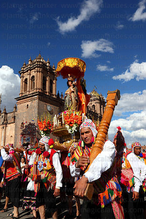 Devotees of Virgen de Natividad de Almudena during parades for Corpus Christi festival and cathedral, Plaza de Armas , Cusco ...
