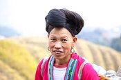 Yao ethnic minority women on rice terrace, Guilin, China