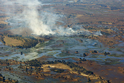 Aerial view of the Okavango Delta, with high water and bush fire, Okavango Delta, Botswana,  June 25, 2014 .