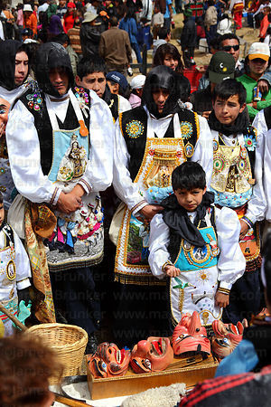 Panadero dance group at grave of deceased relatives in cemetery , Virgen del Carmen festival , Paucartambo , Peru