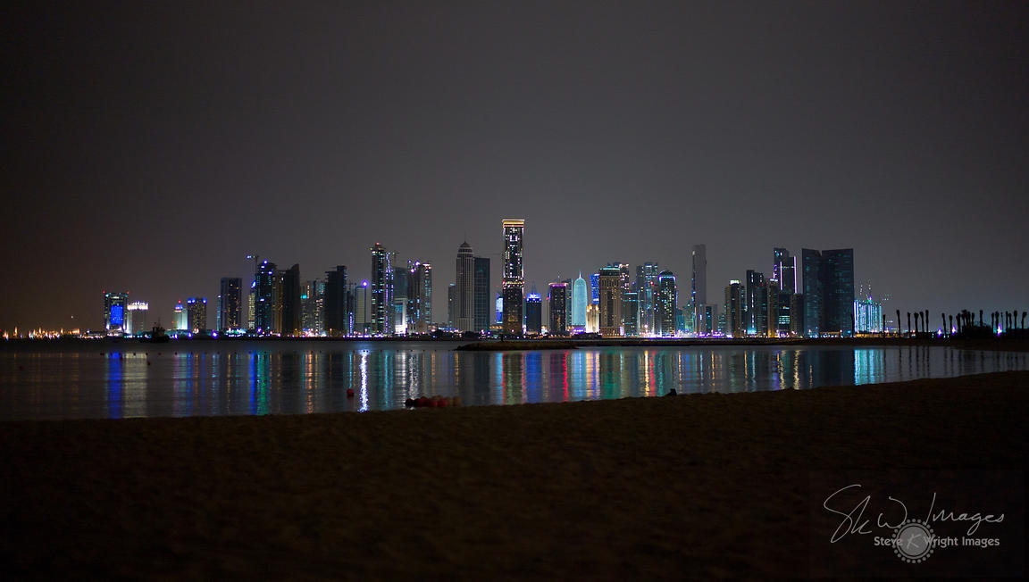 City skyline at night, along the waterfront - Doha, Qatar