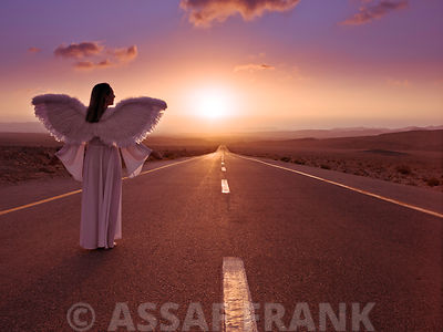 Angel standing on a road at sunrise