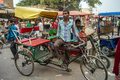 A Rickshaw Wallah Waits For A Passenger