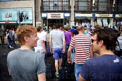 Large Group of Men in Summer Shorts Crossing a road Toward a Topman Store