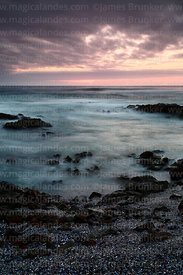 Rocky shoreline after sunset and Pacific Ocean, Iquique, Chile