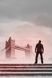 An atmospheric image of a mystery men standing on some steps near Tower Bridge, London, England.