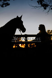 horse and owner in silhouette