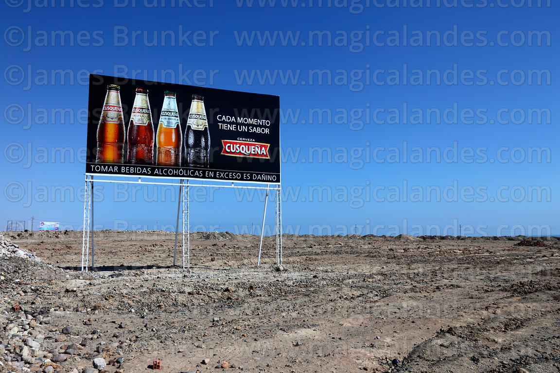 Cusqueña beer advertising sign in desert near Ilo, Peru