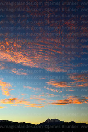 Fiery sunrise above Mt Illimani, Cordillera Real, Bolivia