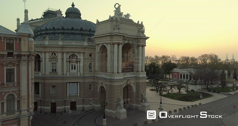 Aerial camera flies slowly towards the Odessa Opera Theatre at sunrise Ukraine