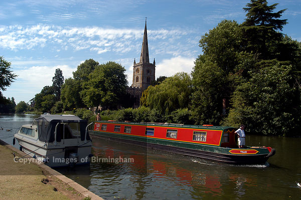 Boats at Stratford upon Avon, Warwickshire. Swans and riverboats, river Avon. Canal boat.