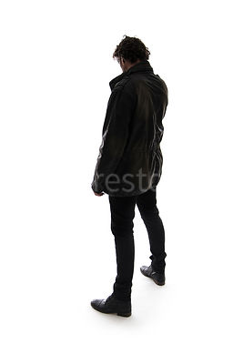 A Figurestock image of a mystery man, from behind, in silhouette – shot from eye level.