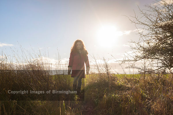 Child walking in the countryside, Shropshire