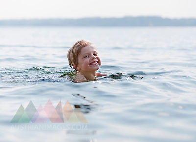 M5, boy swimming in lake, Ambach, Germany