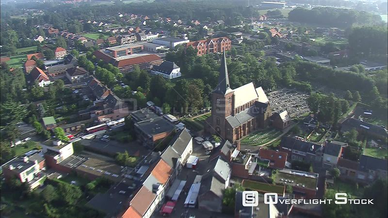Flying past a church spire in Westerlo, Belgium