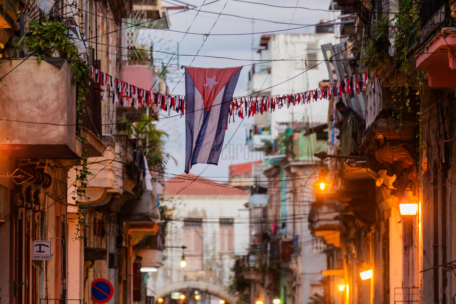 Cuban flag between Havana Apartment Buildings