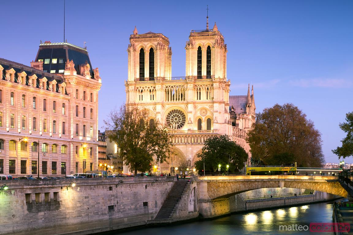 notre Dame cathedral illuminated at dusk, Paris, France