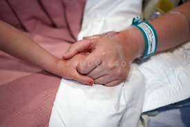 Hospital Patient Holding Child's Hand