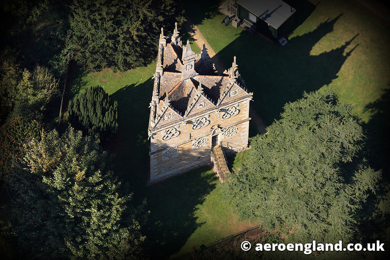 aerial photograph of Rushton Triangular Lodge Northamptonshire. England UK, and Elizebethen Lodge built at the end of the 16t...