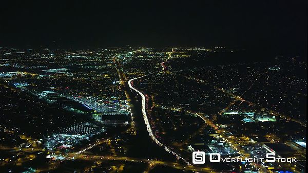 Timelapse Flight Over Los Angeles Traffic at Night, Then Approaching Airport.