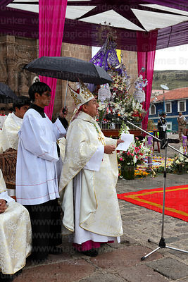 Assistant holding umbrella above bishop of Puno Jorge Carrion Pablisch during central mass, Virgen de la Candelaria festival,...