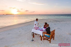 Couple eating dinner on the beach, Maldives
